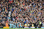 QPR fans celebrate with Queens Park Rangers forward Idriss Sylla (40) after his winner during the EFL Sky Bet Championship match between Fulham and Queens Park Rangers at Craven Cottage, London, England on 1 October 2016. Photo by Jon Bromley.