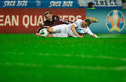 Igors Tarasovs  of Latvia vs Jasmin Kurtic  of Slovenia during the 2020 UEFA European Championships group G qualifying match between Slovenia and Latvia at SRC Stozice on November 19, 2019 in Ljubljana, Slovenia. Photo by Vid Ponikvar / Sportida