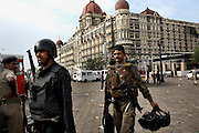 Commandos return from securing the Taj Mahal Hotel.