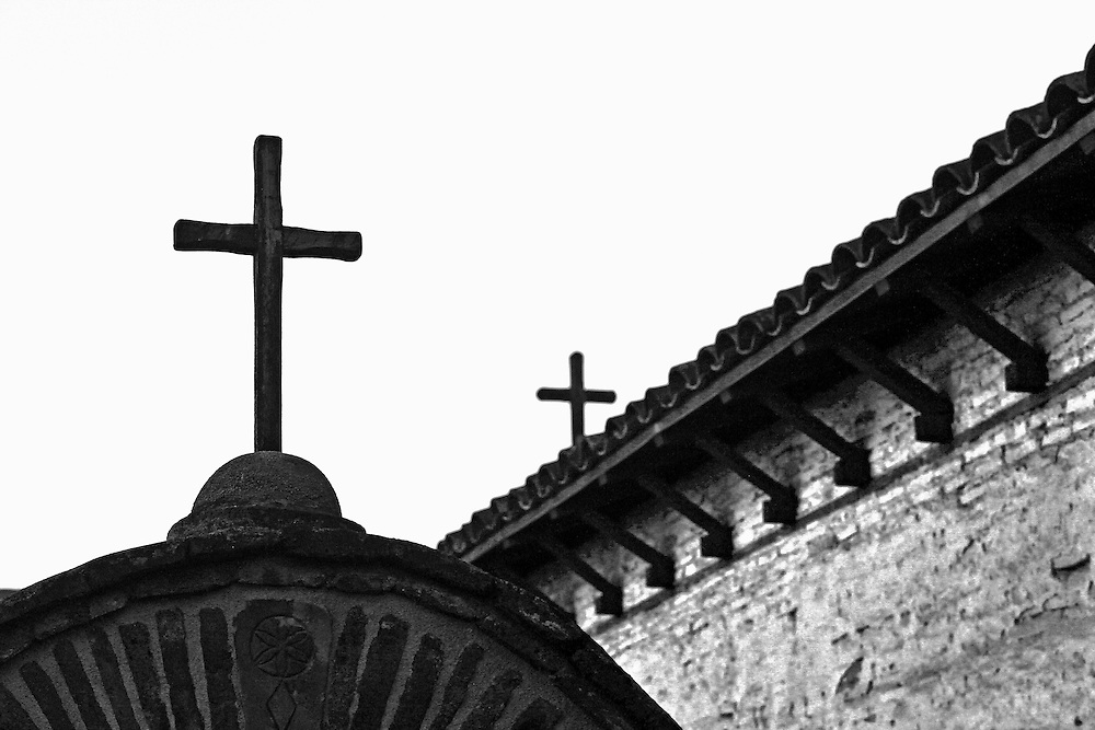 Religious crosses on a rooftop of Mission San Juan Capistrano in California.