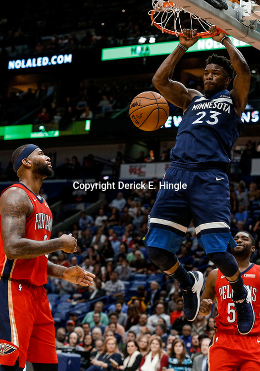 Nov 29, 2017; New Orleans, LA, USA; Minnesota Timberwolves guard Jimmy Butler (23) dunks over New Orleans Pelicans center DeMarcus Cousins (0) during the second quarter at the Smoothie King Center. Mandatory Credit: Derick E. Hingle-USA TODAY Sports