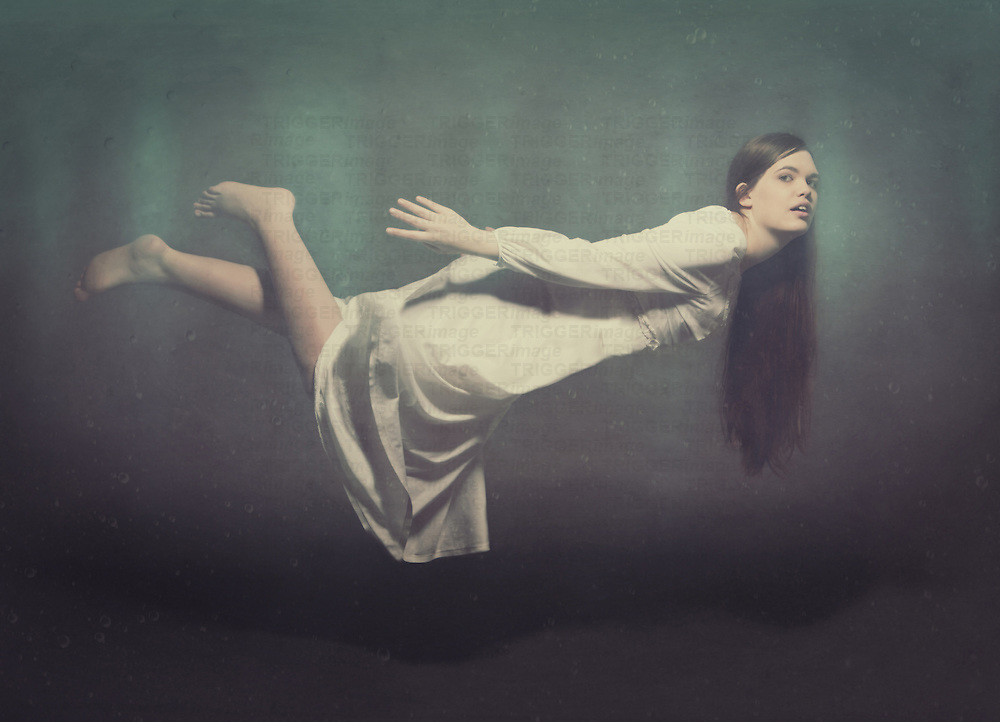 Conceptual image of female floating