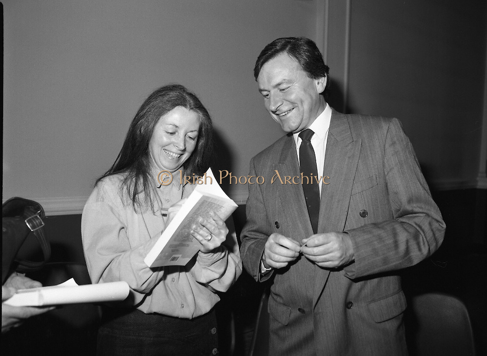 """""""These Obstreperous Lassies"""" Book Launch.  (R93)..1988..15.12.1988..12.15.1988..15th December 1988..A book which chronicles an important aspect of Irish social history was launched in Larkin Hall. """"These Obstreperous Lassies"""" written and researched by Mary Jones, details the seventy three years of the Irish Women Workers Union and of the women who were involved in the union..With Countess Markievicz as its first president, The Union began the fight for equal pay and fair treatment under the leadership of women like helen Chenevix, Louise Bennett and Helena Molloy. They fought for the rights of vulnerable workers such as Laundresses,print workers,box makers,nurses and dressmakers..The Author, Mary Jones, is a full time researcher specialising in Women and Work...Picture shows the Author Mary Jones autographing a copy of her book """"These Obstreperous Lassies""""for John Horgan at the book launch."""