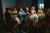 Sept. 11, 2013 - New York, NY - Designer Danilo Gabrielli (blue shirt) wins with his collection of outfits made out of  Subway sandwich accessories for the Project Subway fashion show at Chelsea Piers.<br /> (Photo by Robert Caplin)