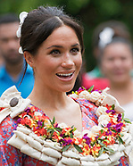Garlanded Meghan Markle Visits University