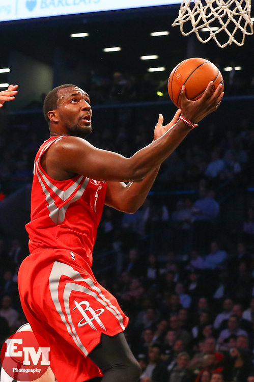 Apr 1, 2014; Brooklyn, NY, USA; Houston Rockets forward Jordan Hamilton (5) takes a shot during the second quarter of their game against the Brooklyn Nets at Barclays Center.