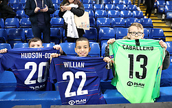 Chelsea fans celebrate after getting Chelsea's Callum Hudson-Odoi, Willian, and Willy Caballero's shirts after the game