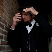 John King prepares himself for the Abraham Lincoln look-alike contest at the Shriver House Museum in Gettysburg, PA, during the Sesquicentennial Anniversary of the Battle of Gettysburg on Wednesday, July 3, 2013.  John Boal Photography