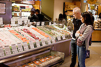 "2 October, 2008. New York, NY. Customers are here at The Wild Edibles fish stand at the Grand Central Market, which displays its fresh products with Country of Origin Labels (COOL). The signs and symbols on the labels also indicate the sustainability of the seafood. Wild Edibles came up with the idea 2 years ago and implemented it last year, though the COOL is not mandatory for them, since the total amount of their invoicing does not require it. ""We do it because this way people are more aware of where the food they purchase comes from"", says Steve Schafel, director of retail operations. ""We do it as a service for our customers"".<br /> <br /> ©2008 Gianni Cipriano for The New York Times<br /> cell. +1 646 465 2168 (USA)<br /> cell. +1 328 567 7923 (Italy)<br /> gianni@giannicipriano.com<br /> www.giannicipriano.com"