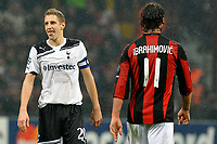 Michael Dawson (Tottenham) e Zlatan Ibrahimovic (Milan) <br /> Milan Tottenham - UEFA Champions League 2010-2011 - Andata degli Ottavi di Finale<br /> Stadio Giuseppe Meazza, Milano, 15/02/2011<br /> © Giorgio Perottino / Insidefoto