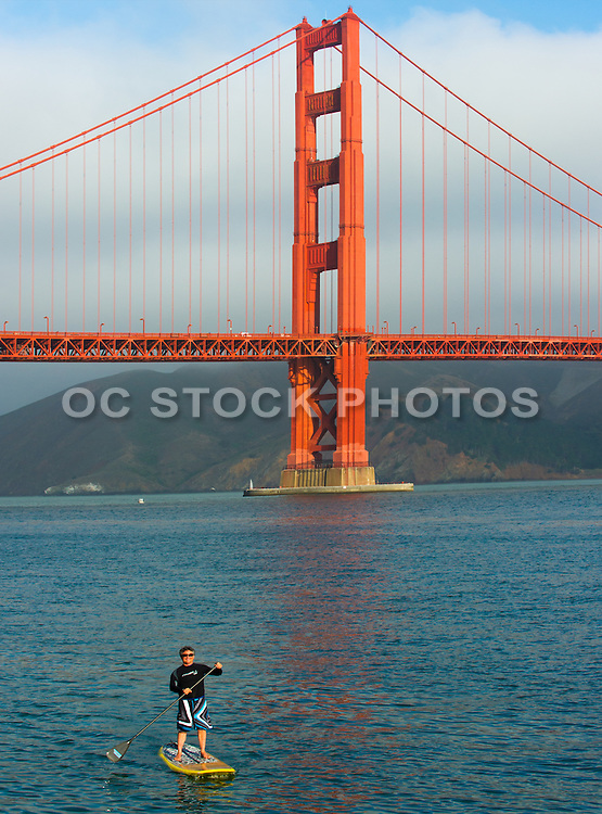 A Man Stand Up Paddling in the San Francisco Bay by the Golden Gate Bridge