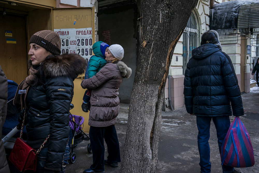 People gather outside a center where they are able to register for benefits available to those displaced by the fighting between Ukrainian forces and Pro-Russian rebels on Wednesday, February 11, 2015 in Kharkiv, Ukraine.