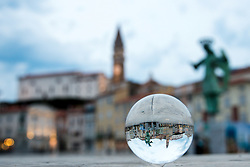 After two months of restoration, the Archangel Michael's statue, made of copper plate, returned to Piran. The image shows view of Archangel Michael's statue and St. George's Parish Church trough lensball before helicopter placing it on top of the church's clock, on October 15, 2018 in Piran, Slovenia. Photo by Matic Klansek Velej / Sportida