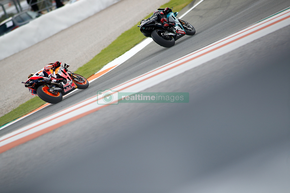 November 17, 2019, Cheste, VALENCIA, SPAIN: Fabio Quartararo, rider of Petronas Yamaha SRT from France, and Marc Marquez, rider of Repsol Honda Team from Spain, during the Race of the Valencia Grand Prix of MotoGP World Championship celebrated at Circuit Ricardo Tormo on November 16, 2019, in Cheste, Spain. (Credit Image: © AFP7 via ZUMA Wire)