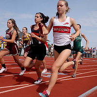 Maple Grove's Caroline Benson at the start of 3200 meter relay photo by Mark L. Anderson
