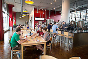 Beer enthusiasts enjoy samples at the Tin Whiskers Brewing Company in St. Paul, Saturday, May 31, 2014. [ BEN BREWER • Special to the Star Tribune _ Assignments #  20034753A  DATE: May 31, 2014 SLUG: greenline.vita EXTRA INFORMATION:
