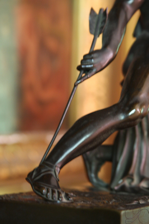 Achilles heel - shown pierced in battle and the forever knows as a weak point for an otherwise impregnable force or plan.