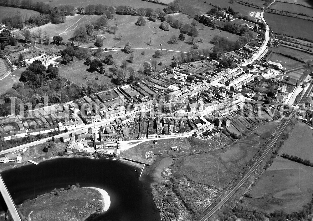 A81 Cappoquin.   11/07/53. (Part of the Independent Newspapers Ireland/NLI collection.)<br /> <br /> <br /> These aerial views of Ireland from the Morgan Collection were taken during the mid-1950's, comprising medium and low altitude black-and-white birds-eye views of places and events, many of which were commissioned by clients. From 1951 to 1958 a different aerial picture was published each Friday in the Irish Independent in a series called, 'Views from the Air'.<br /> The photographer was Alexander 'Monkey' Campbell Morgan (1919-1958). Born in London and part of the Royal Artillery Air Corps, on leaving the army he started Aerophotos in Ireland. He was killed when, on business, his plane crashed flying from Shannon.