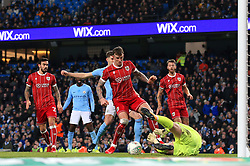 Frank Fielding of Bristol City and Aden Flint of Bristol City deny John Stones of Manchester City  - Mandatory by-line: Matt McNulty/JMP - 09/01/2018 - FOOTBALL - Etihad Stadium - Manchester, England - Manchester City v Bristol City - Carabao Cup Semi-Final First Leg