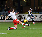 Dundee&rsquo;s Kane Hemmings gets in a cross despite the challenge of Falkirk&rsquo;s David McCracken - Dundee v Falkirk, William Hill Scottish Cup Fourth Round at Dens Park <br /> <br />  - &copy; David Young - www.davidyoungphoto.co.uk - email: davidyoungphoto@gmail.com