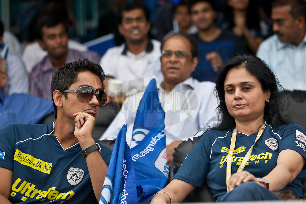 Telegu actor Sidharth(L) during match 53 of the Indian Premier League ( IPL ) between the Deccan Chargers and the Pune Warriors India held at the Rajiv Gandhi International Cricket Stadium in Hyderabad on the 10th May 2011..Photo by Saikat Das/BCCI/SPORTZPICS