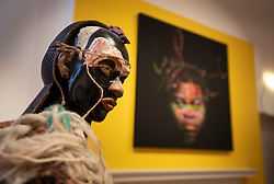 © Licensed to London News Pictures. 11/06/2019. London, UK. Zak Ové's 'La Jablesse, 2013' (L) is displayed with Yinka Shonibare's 'Self Portrait (after Warhol) 6, 2013' at the 'Get Up, Stand Up Now: Generations of Black Creative Pioneers' exhibition at Somerset House, London. This major new exhibition celebrates the past 50 years of Black creativity in Britain and beyond. Beginning with the radical Black filmmaker Horace Ové and his dynamic circle of Windrush generation creative peers and extending to today's brilliant young Black talent globally, a group of around 100 interdisciplinary artists are showcasing their work together for the first time, exploring Black experience and influence, from the post-war era to the present day. The exhibition opens on June 12, 2019 and runs until September 15, 2019.  Photo credit: Peter Macdiarmid/LNP