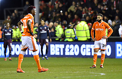 Blackpool players seem dejected as Arsenal's Alex Iwobi (not in frame) scores the third goal of the game during the Emirates FA Cup, third round match at Bloomfield Road, Blackpool.