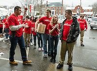 """Officer Eric Adams leads 25 eighth grade LMS students into Vista Foods on their first stop of the day for the """"Sticker Shock"""" program with Stand Up Laconia.  (Karen Bobotas/for the Laconia Daily Sun)"""