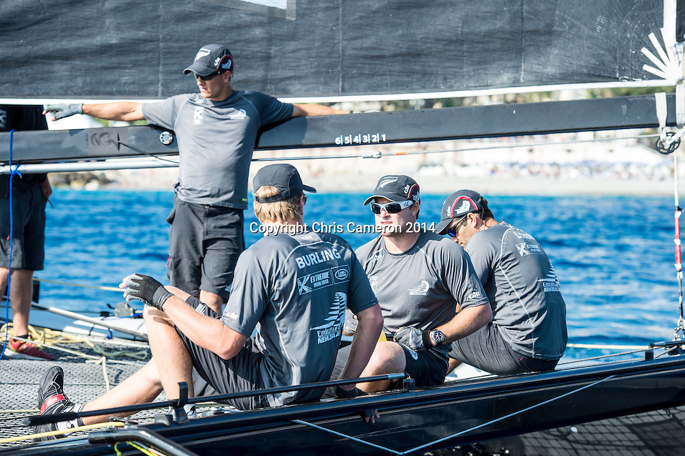 Emirates Team New Zealand getting a few minutes to prepare between races on day two of the Extreme Sailing Series at Nice. 3/10/2014. Photo: Chris Cameron/www.photosport.co.nz