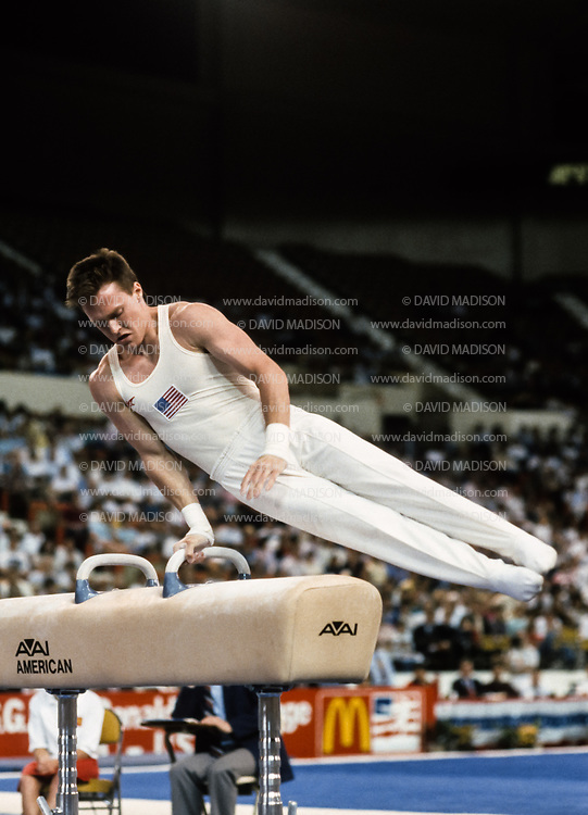 PHOENIX - APRIL 24:  Kevin Davis of the United States competes on the pommel horse during a USA - USSR gymnastics meet on April 24, 1988  at the Arizona Veterans Memorial Coliseum in Phoenix, Arizona.  (Photo by David Madison/Getty Images)