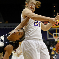 November 16, 2011; Baton Rouge, LA; LSU Tigers forward Theresa Plaisance (24) strips away the ball from Georgetown Hoyas forward Adria Crawford (5) during the second half of a game at the Pete Maravich Assembly Center. LSU defeated Georgetown 51-40. Mandatory Credit: Derick E. Hingle-US PRESSWIRE
