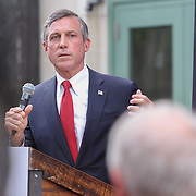 Delaware Governor John Carney delivers remarks as Mayor Mike Purzycki and City Council President Hanifa Shabazz, D.H.L. (RIGHT) listens during the changing of the guard as live nation takes over The Queen Theater Wednesday, June 14, 2017 on Market Street in downtown Wilmington Delaware.