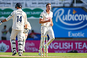 Wicket Morne Morkel of Surrey celebrates bowling James Vince of Hampshire caught Ben Foakes of Surrey during the Specsavers County Champ Div 1 match between Surrey County Cricket Club and Hampshire County Cricket Club at the Kia Oval, Kennington, United Kingdom on 18 August 2019.