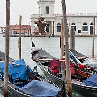 VENICE, ITALY - FEBRUARY 04:  Gondolas rest on the Grand Canal facing Punta della Dogana where amodel of a giant bull - the 2012 edition symbol of Venice Carnival -has been placed on February 4, 2012 in Venice, Italy. The Carnival of Venice (Carnevale di Venezia) is an annual festival and starts 40 days before Easter and ends on Shrove Tuesday ( Martedì Grasso).  (Photo by Marco Secchi/Getty Images)
