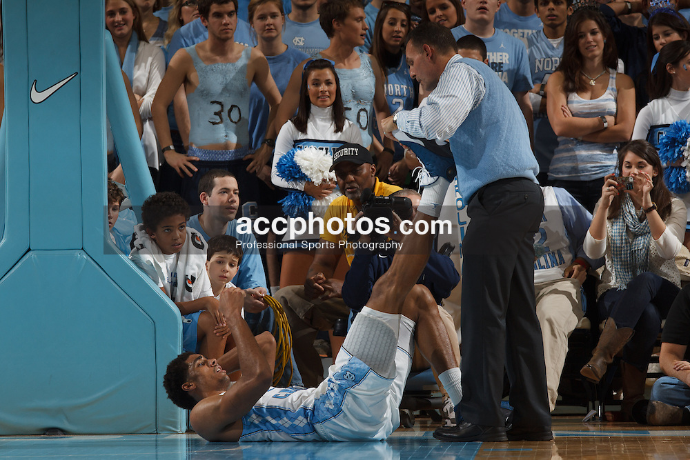 CHAPEL HILL, NC - DECEMBER 29: james Michael McAdoo #43 of the North Carolina Tar Heels is stretched by athletic trainer Chris Hirth during a game against the UNLV Rebels on December 29, 2012 at the Dean E. Smith Center in Chapel Hill, North Carolina. North Carolina won 73-79. (Photo by Peyton Williams/UNC/Getty Images) *** Local Caption *** James Michael McAdoo;Chris Hirth