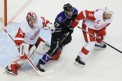 Jimmy Howard (Detroit Red Wings, #35) and Nicklas Lidstrom (Detroit Red Wings, #5) vs Wayne Simmonds (Los Angeles Kings, #17) during ice-hockey match between Los Angeles Kings and Detroit Red Wings in NHL league, February 28, 2011 at Staples Center, Los Angeles, USA. (Photo By Matic Klansek Velej / Sportida.com)