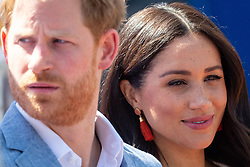 The Duke and Duchess of Sussex during a visit to the Tembisa township in Johannesburg, on day ten of their tour of Africa, to see the work of Youth Unemployment Services, which aims to create new work opportunities for young South Africans. PA Photo. Picture date: Monday September 23, 2019. See PA story ROYAL Tour. Photo credit should read: Dominic Lipinski/PA Wire