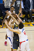 LA Clippers guard Milos Teodosic (4) fouls Golden State Warriors center Zaza Pachulia (27) during a layup attempt at Oracle Arena in Oakland, California, on February 22, 2018. (Stan Olszewski/Special to S.F. Examiner)