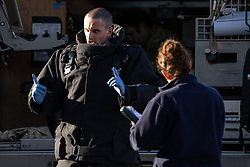 © Licensed to London News Pictures . 14/05/2020. Manchester, UK.  An member of the bomb disposal team speaks to police at the scene after examining the suspicious device . Police, fire and The Royal Logistics Corps respond to a scene at an industrial unit in Trafford Park. Greater Manchester Police say that, whilst searching a vehicle seized yesterday evening (13th May 2020) in Salford as part of an investigation in to drugs, a suspicious device was discovered . Photo credit: Joel Goodman/LNP