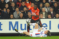 FOOTBALL - FRENCH CHAMPIONSHIP 2010/2011 - L1 - STADE RENNAIS v OLYMPIQUE LYONNAIS - 6/11/2010 - PHOTO PASCAL ALLEE / DPPI - ALEXANDER TETTEY (RENNES) / KIM KALSTROM (OL)