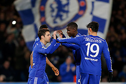 Cesc Fabregas of Chelsea celebrates with Diego Costa after scoring a goal from the penalty spot to make it 1-0 - Photo mandatory by-line: Rogan Thomson/JMP - 07966 386802 - 10/12/2014 - SPORT - FOOTBALL - London, England - Stamford Bridge - Sporting Clube de Portugal - UEFA Champions League Group G.