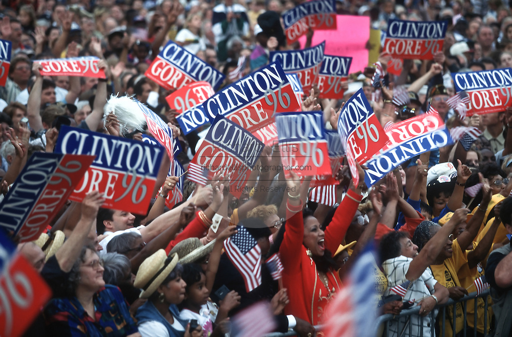 President Bill Clinton supports wave signs during a campaign stop for his re-election August 27, 1996 in Pontiac, MI