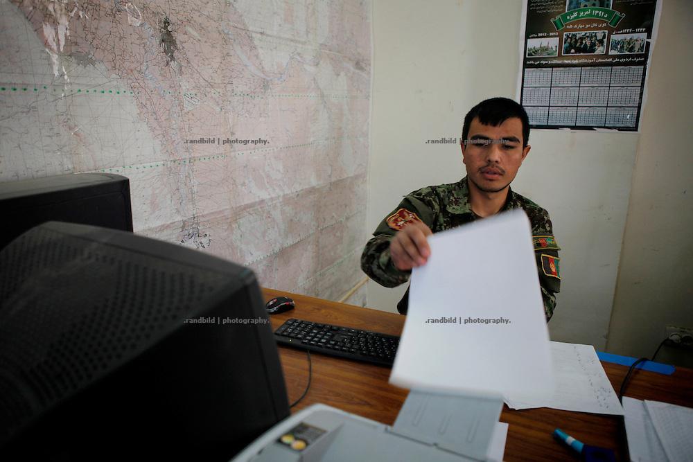 ANA soldiers doing administrative work in Camp Pamir, Kunduz.