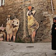 Wall paintings in Orgosolo, Sardinia, Italy. Peintures murales dans une rue d'Orgosolo, Sardaigne, Italie.