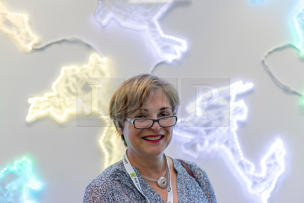 © Licensed to London News Pictures. 06/10/2016. London, UK. Artist, Susan Rosenberg shows her laser etched works involving LED lights, at the preview of Moniker Art Fair, part of London Art Week, taking place at the Old Truman Brewery, near Brick Lane.  Now in its seventh year, the fair embraces contemporary art from emerging and established artists, the majority of whom attend the fair in person in order to meet potential collectors and to show their work. Photo credit : Stephen Chung/LNP