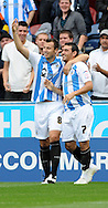 Picture by Graham Crowther/Focus Images Ltd. 07763140036.10/9/11 .Gary Roberts of Huddersfield celebrates hi goal againstTranmere during the Npower League 1 game at the Galpharm Stadium, Huddersfield.