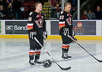 KELOWNA, CANADA, JANUARY 1: Cody Sylvester #16 and Dany Gayle #22 of the Calgary Hitmen line up at the start of the game as the Calgary Hitmen visit the Kelowna Rockets on January 1, 2012 at Prospera Place in Kelowna, British Columbia, Canada (Photo by Marissa Baecker/Getty Images) *** Local Caption ***