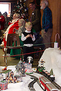 Visitors watch Santa's Christmas Train  as others have their picture taken with Santa during the Christmas Gathering at Polen Farm in Kettering, Sunday, December 25, 2011.  Also available were refreshments and crafts.