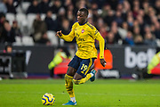 Nicolas Pepe (Arsenal) heads towards the goal during the Premier League match between West Ham United and Arsenal at the London Stadium, London, England on 9 December 2019.