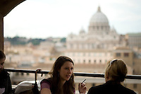 Women having lunch in a restaurant overlooking the Vatican, Rome, Italy